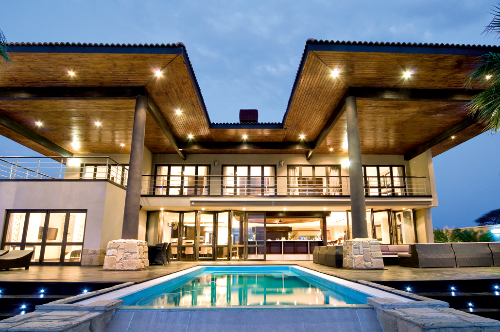 modern double storey house with pool