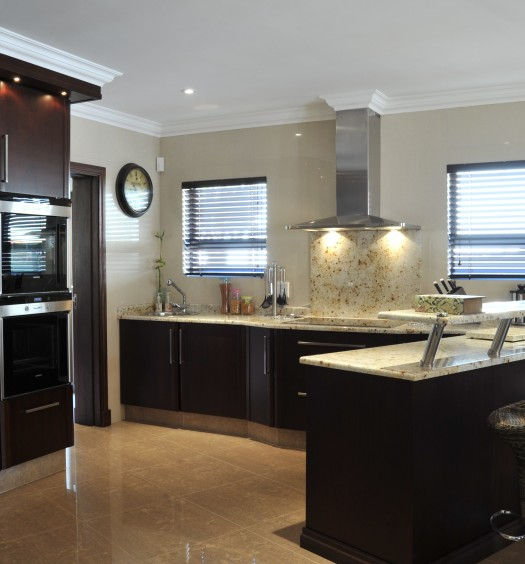 Brown cupboards and granite countetops